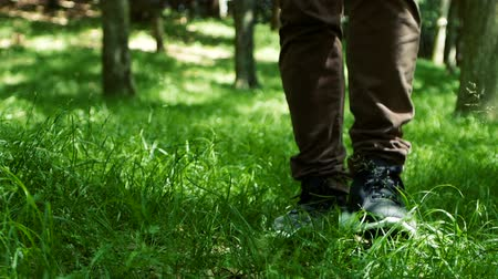 spor ayakkabısı : Slow Motion footage of man and walks on nature way in forest in spring or summer seasonal.