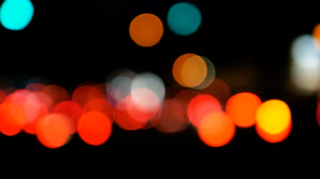 Footage of Night city street lights bokeh background, Defocused car lights, Abstract colorful bokeh