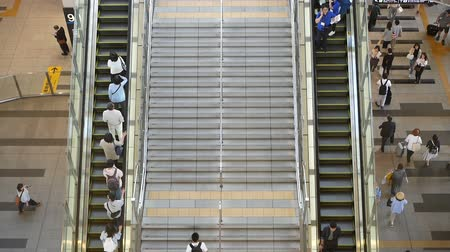 Anonymous crowd of people walking on walk way in rush hour on Osaka station,Japan. Slow motion footage. Top view. Dostupné videozáznamy