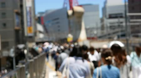 osaka : Anonymous crowd of people walking on walk way in rush hour. Stock Footage