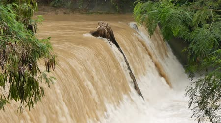 hydro : Big waterfall. Rapid strong flow of water falls down in rainy season.