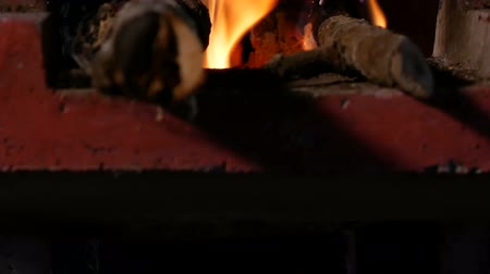 steaming basket : Fire from firewood in terracotta pot footage.
