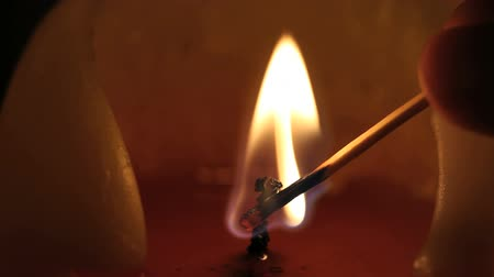match : Macro shot of a candle being lit