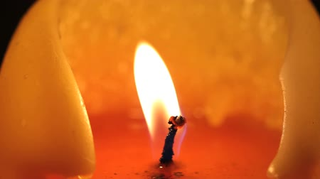 мерцание : Macro shot of a candle burning and being blown out Стоковые видеозаписи