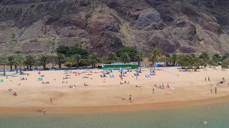 airial : Santa Cruz Tenerife Spain: Drone shot of tourists sunbathing on the Playa de las Teresitas beach