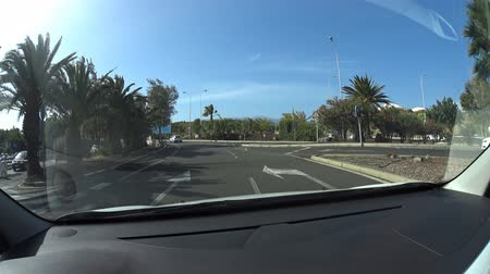 onto : South Airport Tenerife Spain: In car view of car leaving the airport onto highway