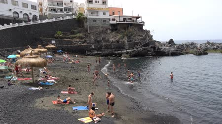 holiday makers : Puerto de Santiago Tenerife Spain: Holiday makers relaxing on small beach
