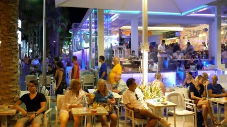 luxe : El Arenal Mallorca Spain: Tourists drinking cocktails in white themed modern bar