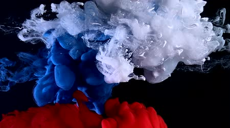 Flag of Russia made of colored ink on a black background. Stylish abstract modern background. White, blue and red watercolor ink in water. A powerful explosion of colors. Cool trending screensaver. Wideo