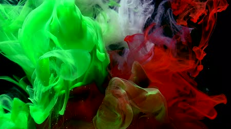 Abstract color background. Green, white and red watercolor ink in water on a black background. Cool trending screensaver. Wideo