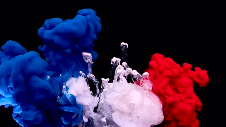 France flag made of colored ink on a black background. Stylish abstract modern background. Blue, white and red watercolor ink in water. A powerful explosion of colors. Cool trending screensaver.
