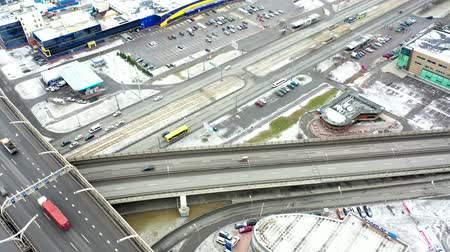 st petersburg : Road junction. Aerial view of the expressway in winter. City landscape in the morning. Drone flight over the city. Stock Footage