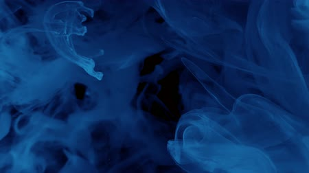 Blue watercolor ink in water on a black background. Abstract space background. Cool trending screensaver. Wideo