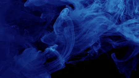 Abstract space background. Blue watercolor ink in water on a black background. Cool trending screensaver.