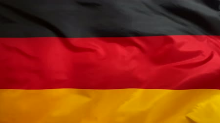 Germany flag waving in the wind close-up. The wind is blowing from right to left. Background for news, movies and more.