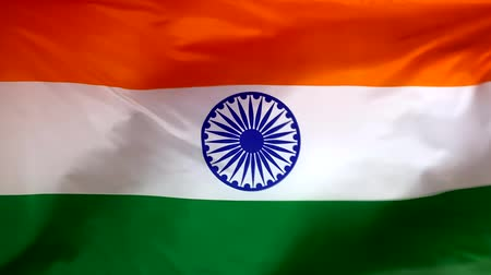 India flag waving in the wind close-up. The wind is blowing from right to left. Background for news, movies and more.
