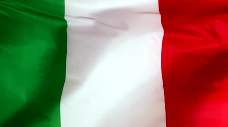 Řím : Italy flag waving in the wind close-up. The wind is blowing from right to left. Background for news, movies and more.