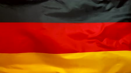 Germany flag waving in the wind. German flag close up.