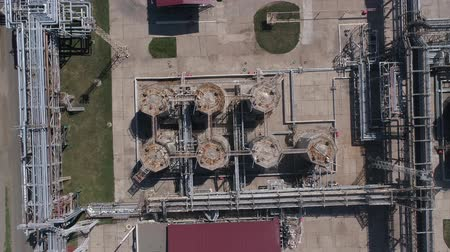 damp : 4K Aerial shot from oil tanks and towers in a refinery