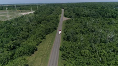 Aerial View of White Truck Passing Busy highway