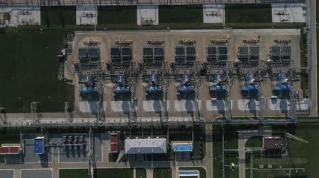 4K Aerial shot from oil tanks and towers in a refinery