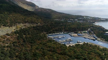 AERIAL. Flying over the shore. Bay with a pier and a yacht Dostupné videozáznamy