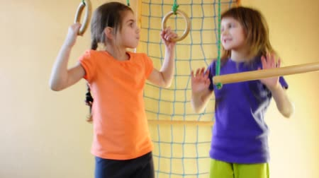 sport dzieci : Two 7 year old girls playing at home gym. Part 1.