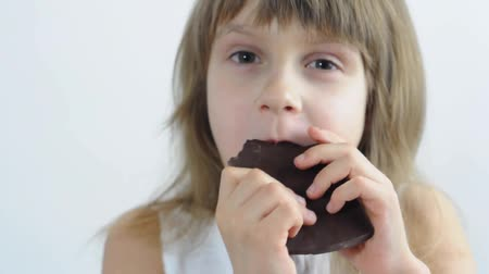 eat background : close-up portrait of a little girl eating chocolate
