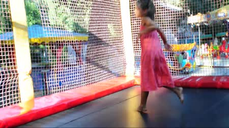 sport dzieci : child jumping on trampoline