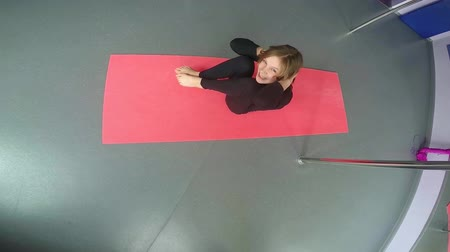 gymnasta : Little sportive girl exercising in dance studio doing sit ups. Sports, active lifestyle, childhood concept.