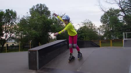 roller blading : Outdoor portrait of a sportive child inline skates blading in the park. Slow motion. Childhood, sports, active lifestyle concept. Stock Footage