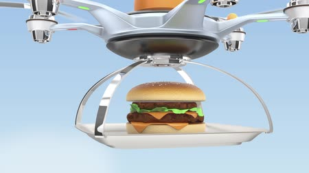 фастфуд : Air drone serving hamburger for fast food take out concept Стоковые видеозаписи