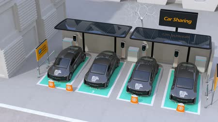 bérlet : Electric car leaving car sharing parking lot. The parking lot equipped with solar panels, charging stations and batteries. 3D rendering animation. Stock mozgókép