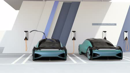 седан : Two electric cars parking in charging station. 3D rendering animation. Стоковые видеозаписи