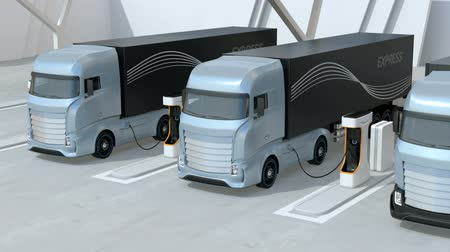 mounted : Generic design blue Heavy Electric Trucks charging at Public Charging Station. The Charging Station Equipped with Roof-Mounted Solar Panels. 3D rendering animation.