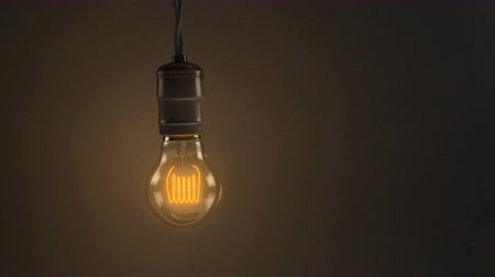 izzók : 00:02 | 00:04 1×  An animated loop of a single swinging vintage incandescent lightbulb over a dark warm background