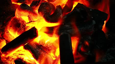 A fire that is burning wood charcoal in the stove for barbecue grill.