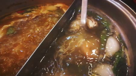 kari : Slow-motion video boil shrimp in a soup pot with meat and vegetables.