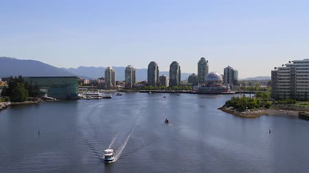 overlooks : VANCOUVER, BRITISH COLUMBIA,CANADA - CIRCA May 2012 :medium angle  aerial - false creek science world Stock Footage