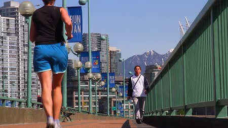 overlooks : VANCOUVER, BRITISH COLUMBIA,CANADA - CIRCA May 2012 :cambie bridge - people exercising