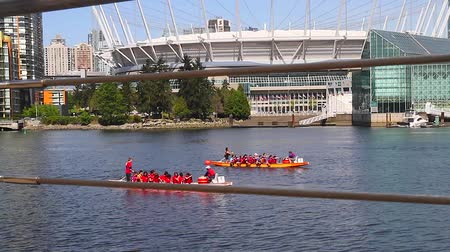 overlooks : VANCOUVER, BRITISH COLUMBIA,CANADA - CIRCA May 2012 :creative dolly shot - dragon boaters beside bc place