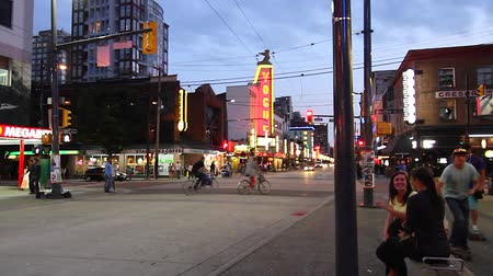 eatery : VANCOUVER, BRITISH COLUMBIA,CANADA - CIRCA May 2012 :dolly shot - evening Granville street district Stock Footage