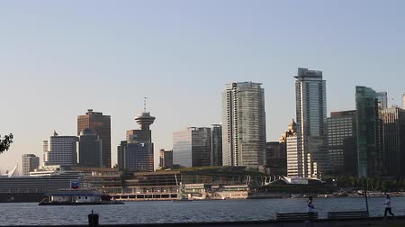 ing : VANCOUVER, BRITISH COLUMBIA,CANADA - CIRCA May 2012 :vancouver skyline  - people exercising hd