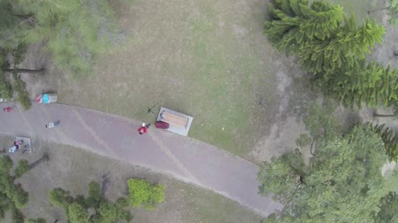daan : drone pilot landing drone at Daan park in slow motion Stock Footage