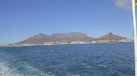 pretoria : CIRCA June 2013 - CAPETOWN ,SOUTH AFRICA - a view of the south african flag and table mountain as seen from a boat heading to Robben island