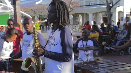 pretoria : CIRCA June 2013 - NEILSPRUIT, KRUGER NATIONAL PARK ,SOUTH AFRICA - a local capetown band at the Capetown waterfront plays a song for the public