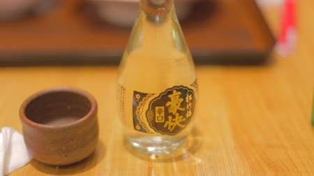 trave : OSAKA, JAPAN - CIRCA October 2014 :close sake bottle and cup to bowl of rice