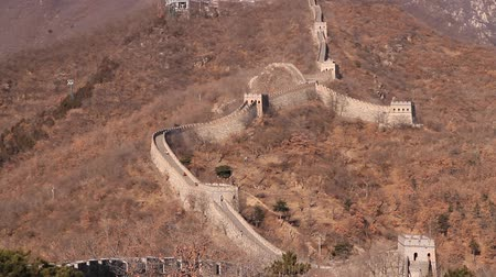 peking : pan of of the great wall features writing with a message from mao
