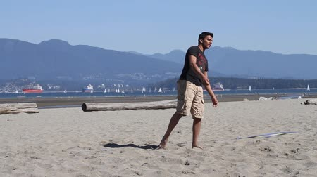 volleyball : VANCOUVER, BC ,CANADA - CIRCA September 2011 :outdoor summer volleyball - young man serves