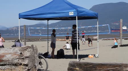 volleyball : VANCOUVER, BC ,CANADA - CIRCA September 2011 :outdoor summer volley - friends watch under tent wide